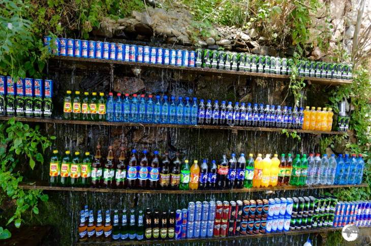 A novel concept for an outdoor drinks shop - drinks are kept cool under the flow of a trickling waterfall.