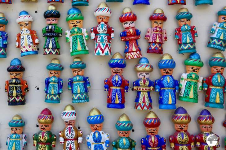 Hand-carved, wooden, souvenir fridge magnets for sale in Bukhara.