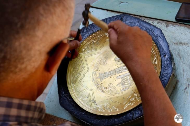 A brass metal worker in Bukhara.