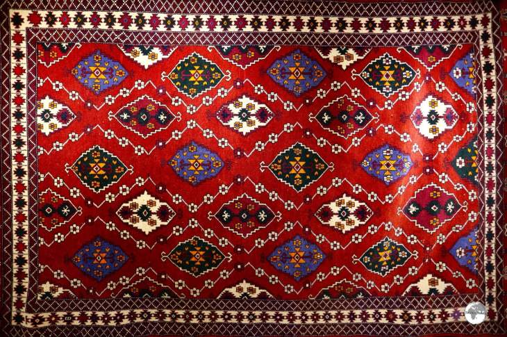 Uzbek carpets are characterised by a field of red-brown tint, which is populated by brightly coloured medallions, which usually appear in geometrical shapes.