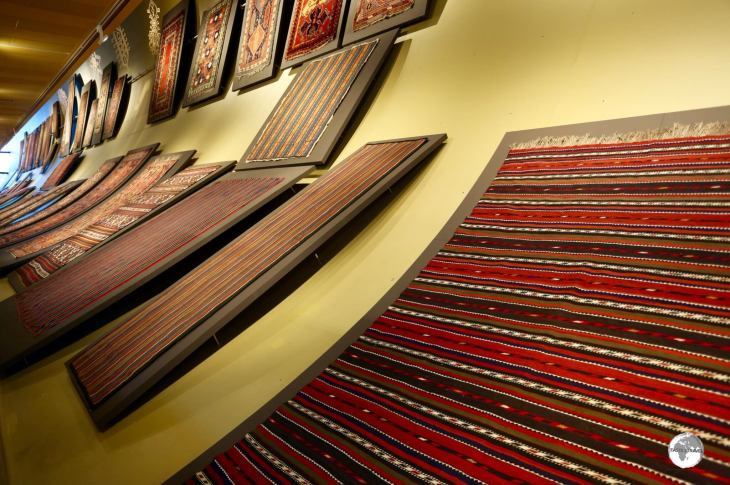 How to display a flat carpet on a curved wall? Carpets on display at the Carpet Museum.