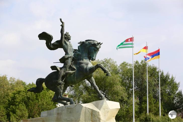 The monument to Suvorov in Tiraspol, with the flags of (l-r) Abkhazia, South Ossetia and the Republic of Artsakh.