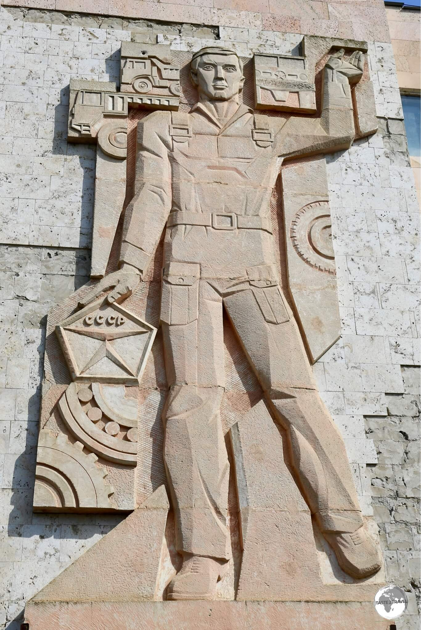 An incredible 'CCCP' stone mosaic on the wall of a factory in Bender.