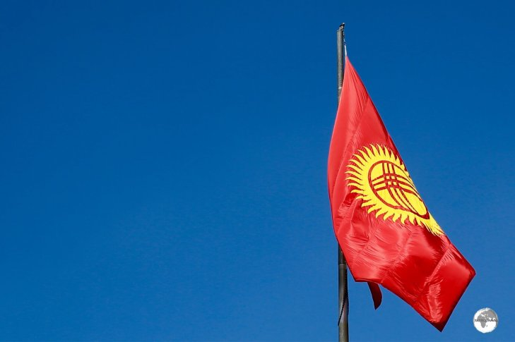 The flag of Kyrgyzstan which features a 'Tunduk' at its centre.