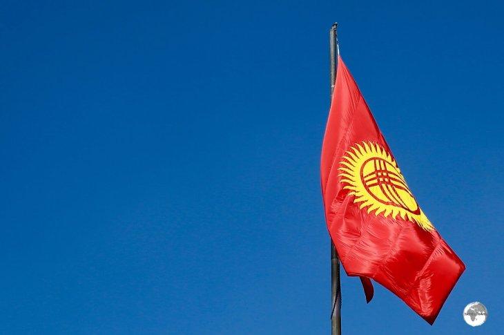 The flag of Kyrgyzstan, flying in Bishkek.
