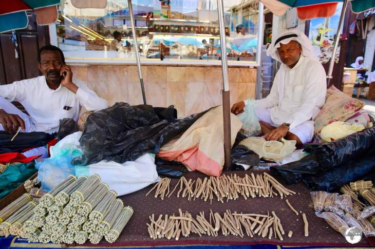 Miswak vendor in Jeddah old town. Used in the region for more than 7,000 years, 'miswak' is a teeth cleaning twig which comes from the Arak tree.