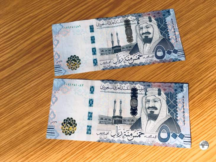 The 500 riyal note features a portrait of King Abdullah.