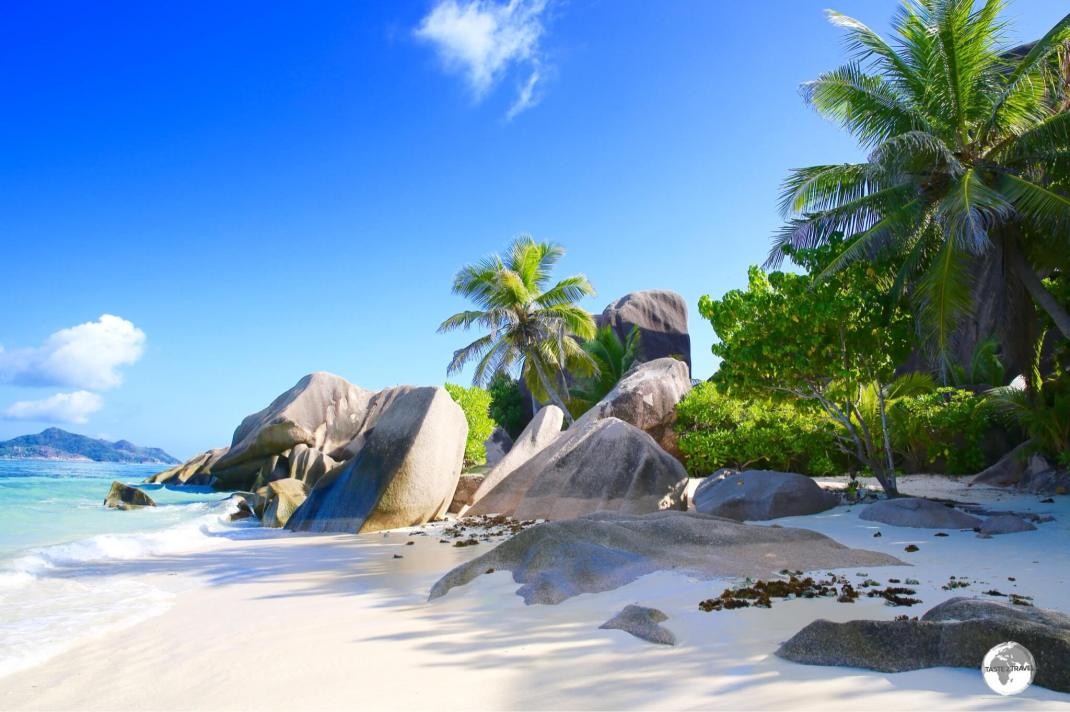 "Anse Source d'Argent has been voted ""the most beautiful beach"" in the world. Praslin island is visible in the background."