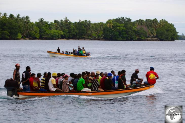 A very full Banana boat, transporting villagers from Madang back to their villages.