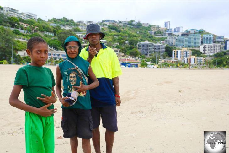 Young boys enjoying a walk along Ela beach.