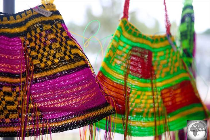 These colourful, hand-woven 'bilums' at Madang market cost K 60 (US$17.60).