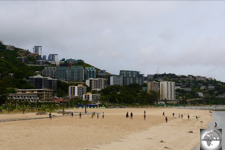The golden sands of Ela beach are a popular recreation area, where local boys love to play rugby.