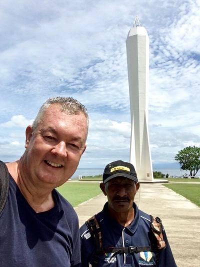 A very hot and sweaty me, exploring the sights of Madang with my security escort - Michael Tom.