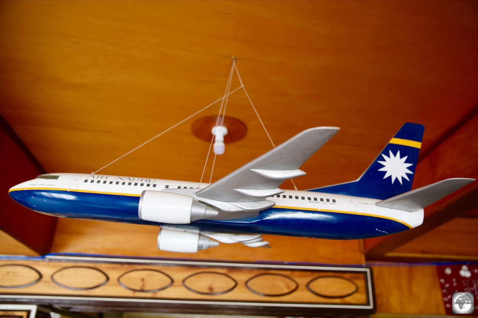 A model of an old Air Nauru plane hangs from the ceiling of the reception at the OD-N-Aiwo Hotel.