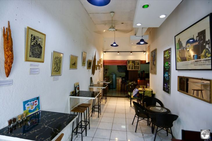 An interior view of Fatima Café, whose walls serve as an art gallery, with works by local artists available for purchase.