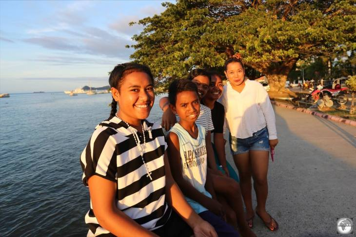 A Timorese family enjoying sunset on the waterfront in Dili.