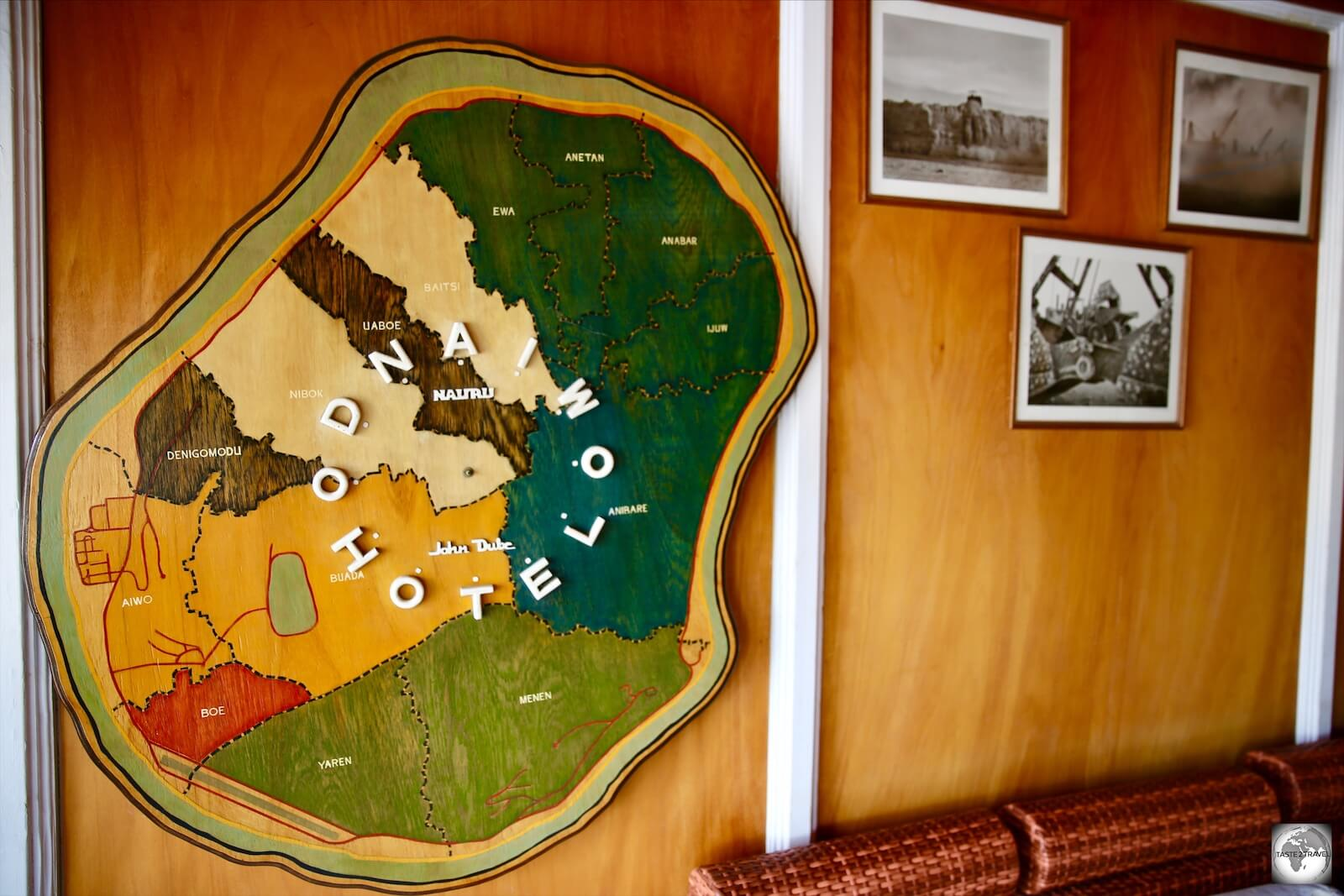 A wooden map of Nauru, showing the different districts, adorns the wall of the OD-N-Aiwo Hotel.