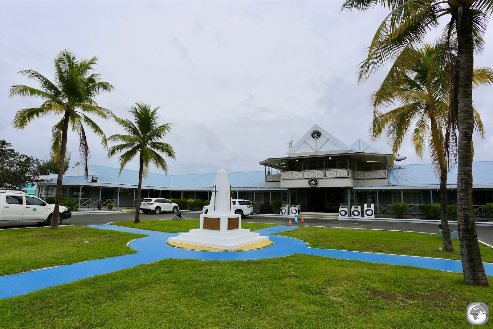 A view of the Ministerial Building with the Nauru War Memorial in the foreground.