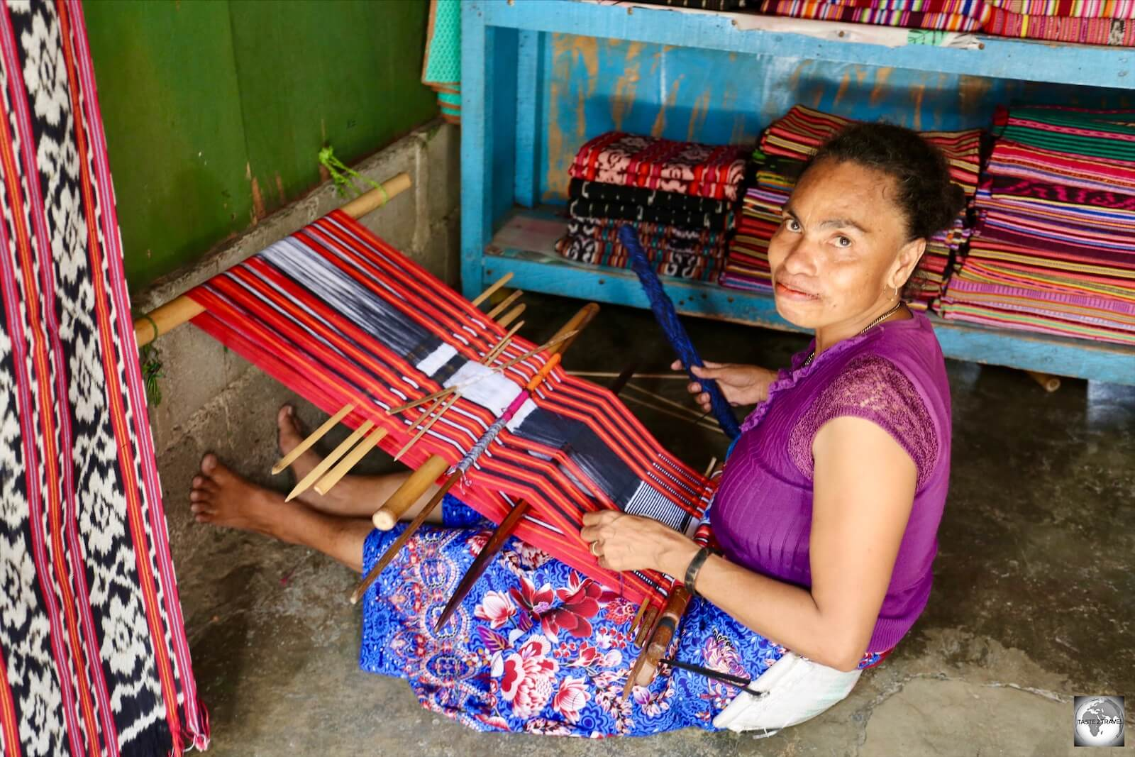 One of the store owners weaving some Tais cloth during a quiet moment.