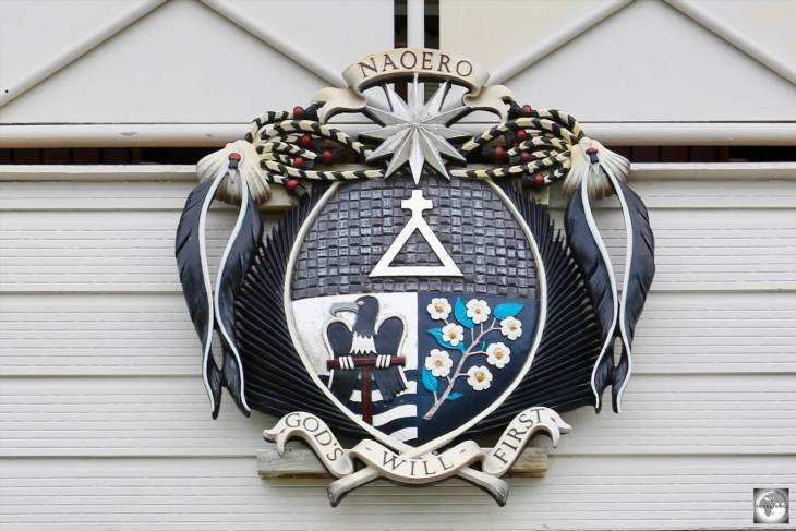 The Nauru coat of arms is displayed above the entrance of the Ministerial Building in Yaren.