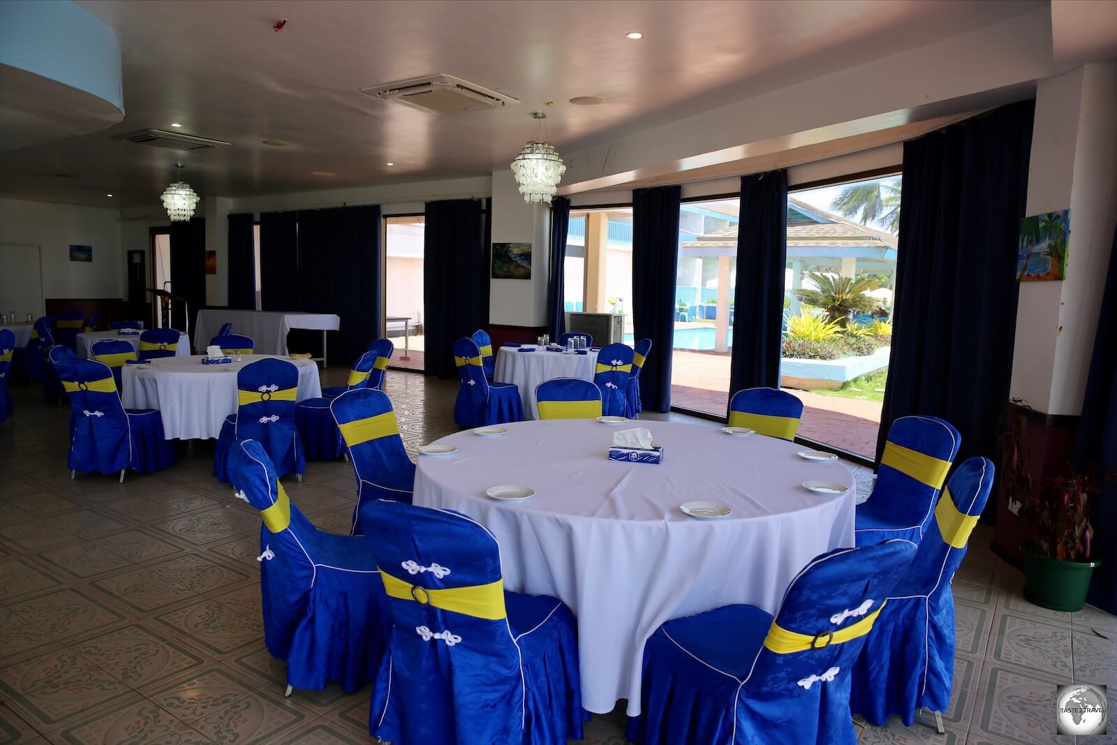 The dining room at the Anibare Restaurant where the chairs are covered in the national colours.