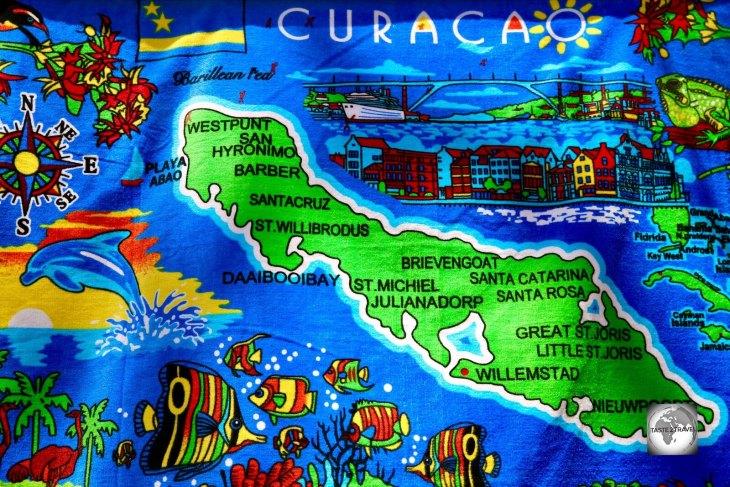 A colourful map of Curaçao adorns a souvenir beach towel.