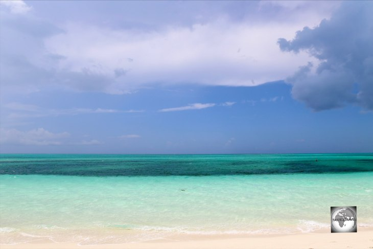 A raised limestone shelf, Provo island is surrounded by pristine turquoise water.