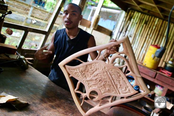 A 'story board' wood carver at his workshop in Koror.