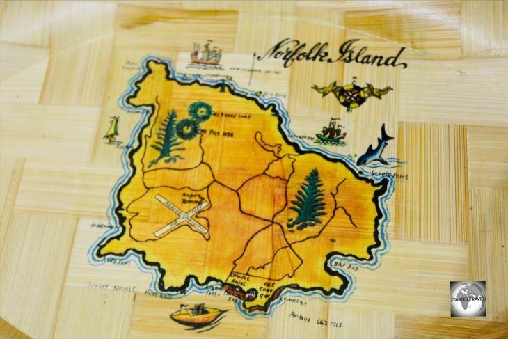 A map of Norfolk Island adorns a souvenir plate.