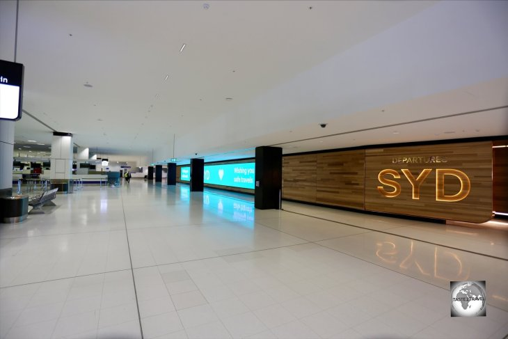 Normally bustling with travellers, a deserted International terminal at Sydney International airport during the Covid-19 pandemic. The flight to Norfolk Island was one of just 12 flights departing that day.