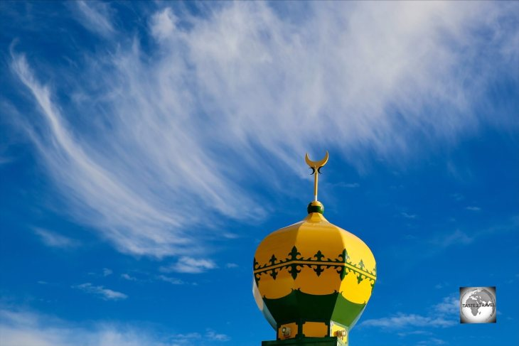 The green and gold minaret of the Home Island mosque.