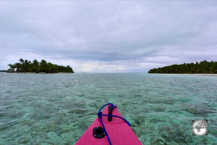 Cruising around the southern islands of the atoll in my motorised canoe.