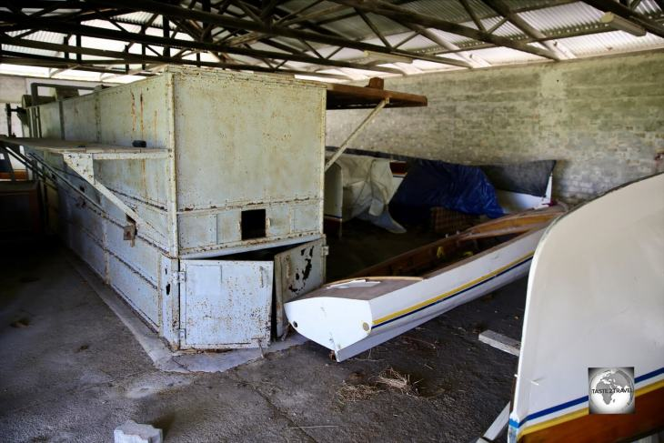 An abandoned oven, which was once used for drying coconuts, and renovated Jukong boats at the Home Island museum.