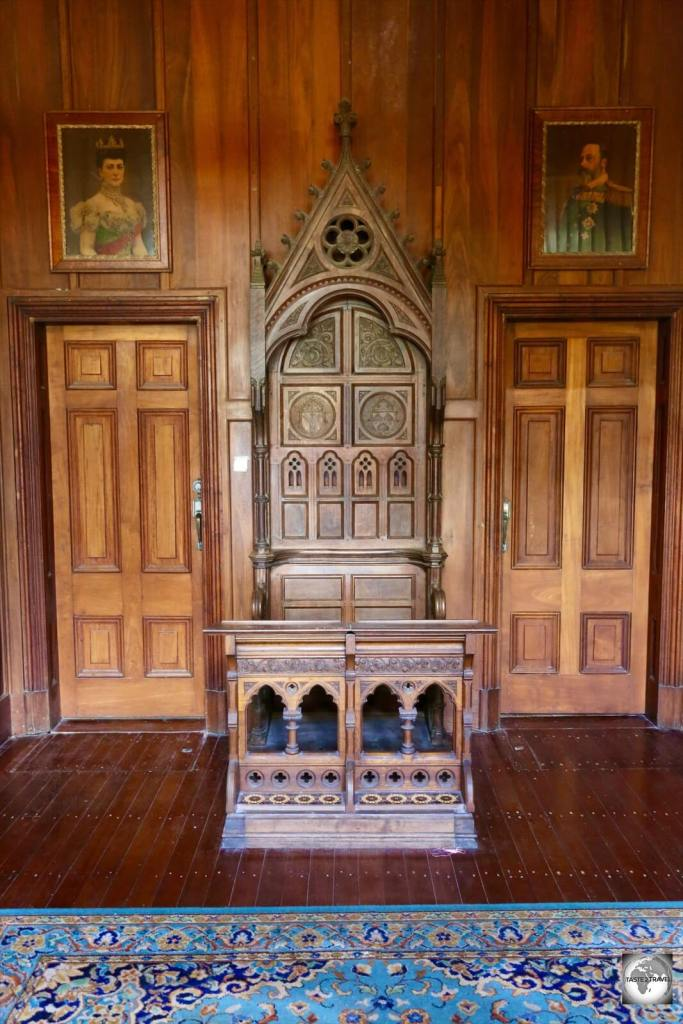 The vestibule of Oceania house features an antique bishop's chair.