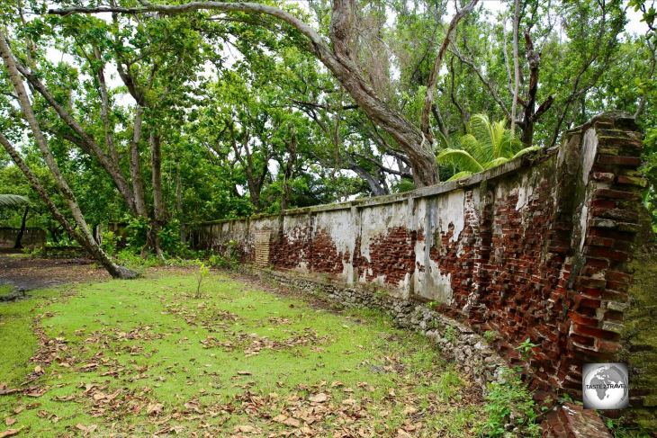 The crumbling brick walls which surround the Clunies-Ross estate on Home Island.