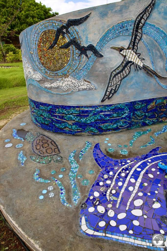 A whale shark, frigatebirds, a booby and more feature on a newly installed, community-made, tile mosaic in the park in The Settlement.