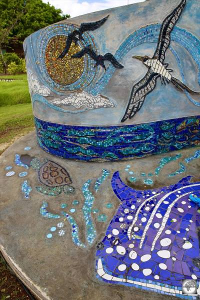 A whale shark, frigatebirds, a booby and more feature on a newly installed, community-made, tile mosaic in the park in Settlement.