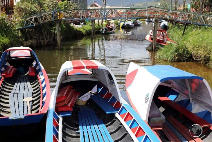 Tour boats at Laguna de la Cocha, waiting to ferry passengers out to the national park on Isla de La Corota.