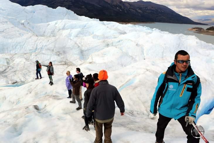 Trekking on the Perito Moreno Glacier in the Los Glaciares National Park, in the southwest of Argentina.