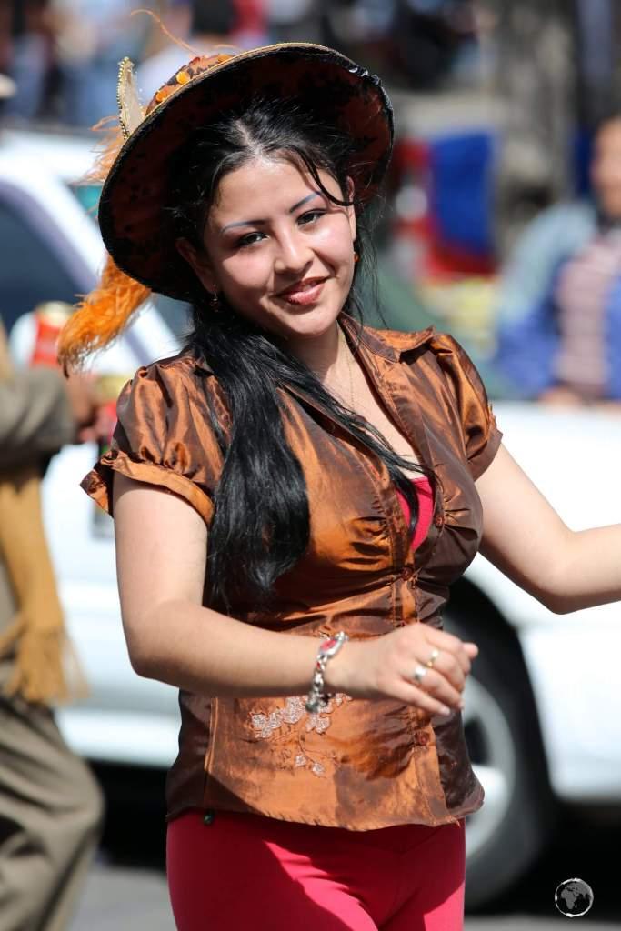 While older participants in the 'Fiesta de la Virgen de Guadalupe' wear traditional costumes, younger dancers wear more modern attire.