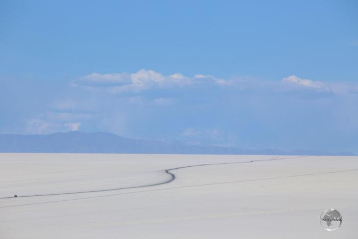 What looks like a tarmac road is actually a track across the Salar de Uyuni, which has been blackened by many rubber tyres.