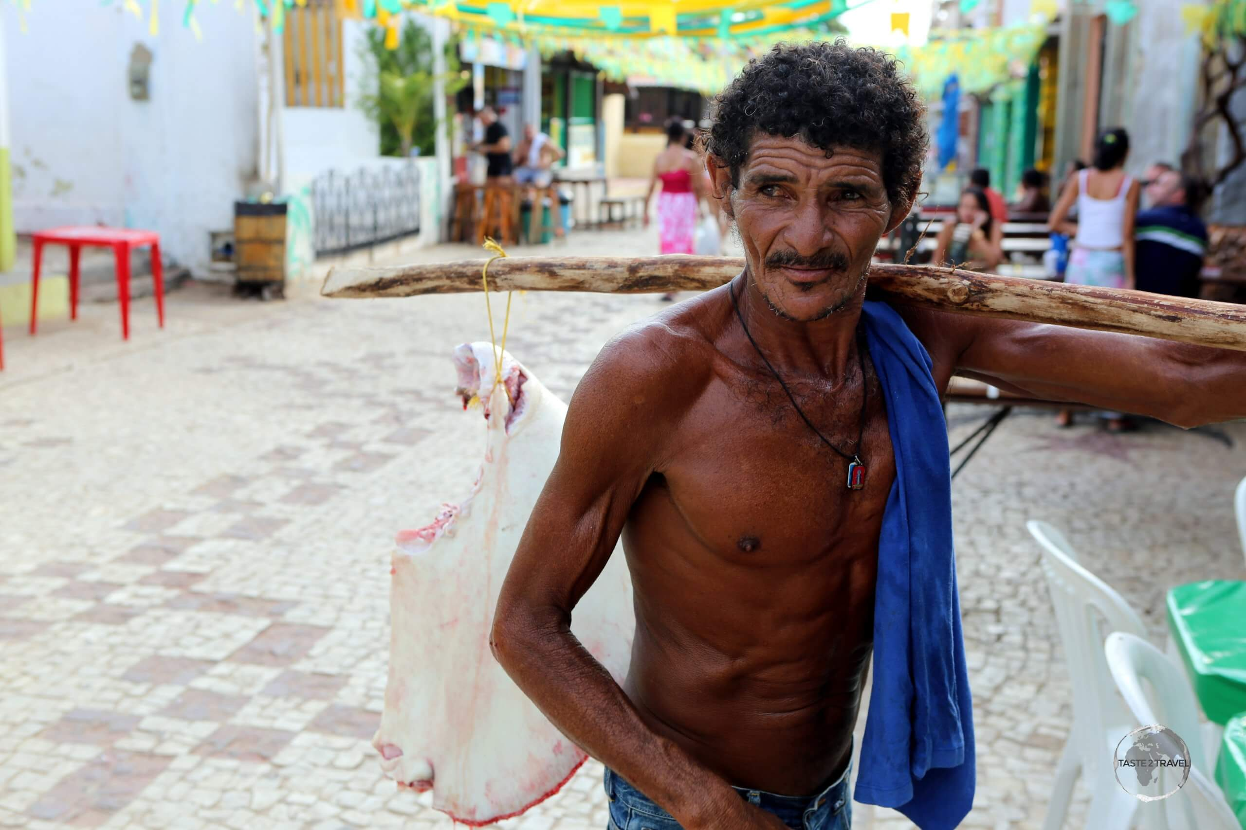 A local fisherman selling part of a stingray in the old town of Canoa Quebrada, Ceará state, Brazil.