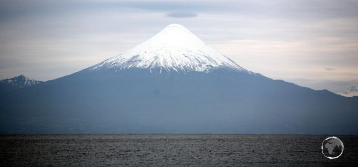 A view of Osorno volcano and Lake Llanquihue from the lakeside town of Puerto Varas, southern Chile.