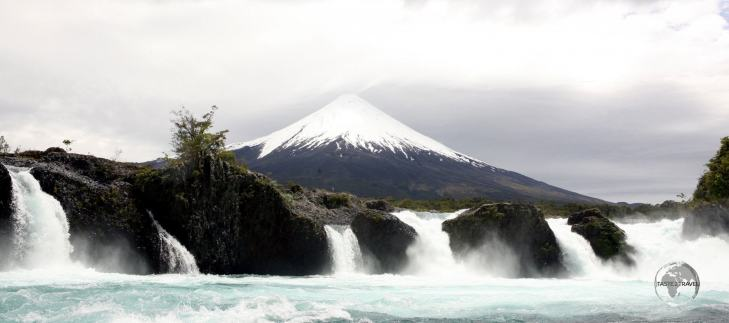 Osorno volcano forms an ideal backdrop to the thundering Petrohué waterfalls, a chute-type waterfall in the upper reach of the Petrohué River in southern Chile.