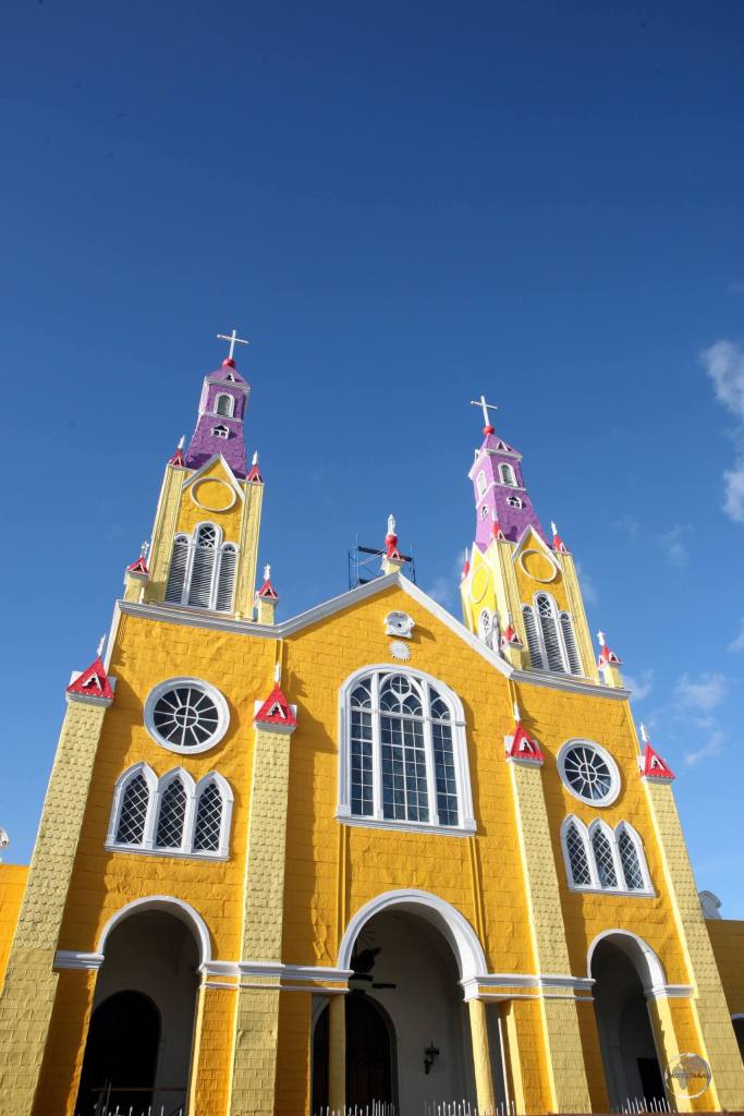 Fronting the Plaza de Armas, the main square of Castro, the capital of Chiloe, the brightly painted 'Iglesia de San Francisco' is listed as a UNESCO World Heritage Site.