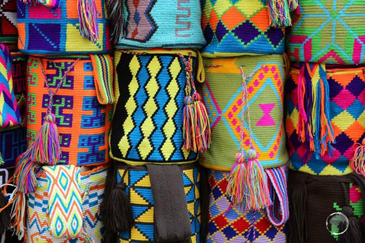 Wayuu Mochila bags for sale at a street-side stall in Cartagena old town.