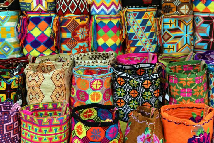 Brightly coloured with beautiful patterns, Wayuu Mochila bags, which are produced by local native Indians, are a popular souvenir item in Cartagena old town.