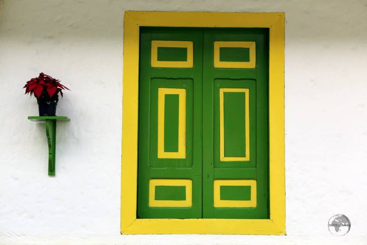 A typical bahareque-style of building in Salento, with stark white walls and brightly painted wooden shutters. With a lack of clear windows, interiors are always dark!