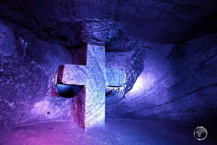 A large cross, hewn out of rock salt, lies in the depths of the Zipaquirá Salt Cathedral in Colombia.