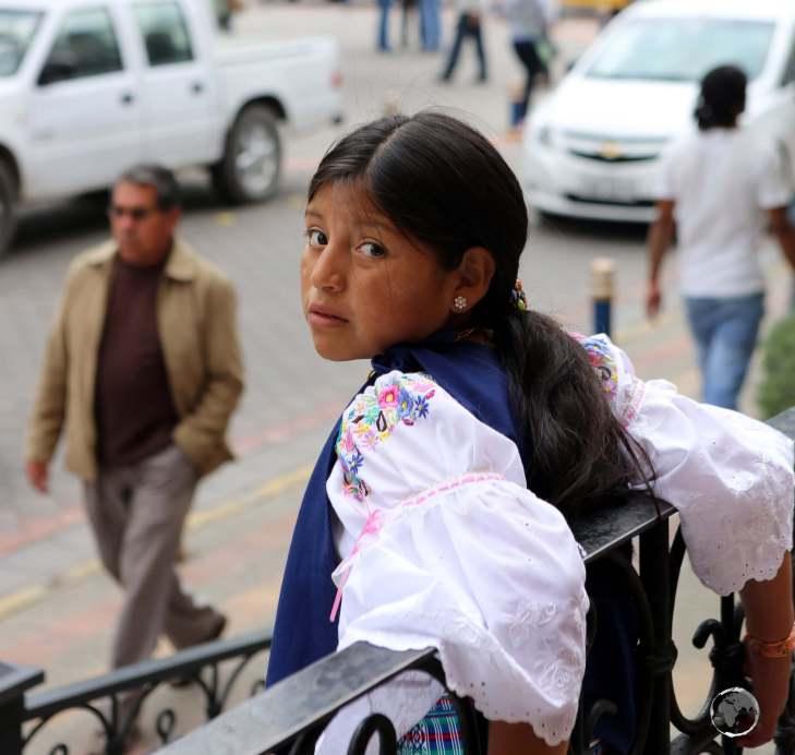 A local Otavaleño native Indian girl in downtown Otavalo.